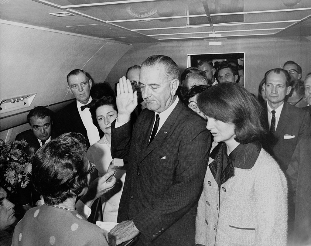 1024px-Lyndon_B._Johnson_taking_the_oath_of_office,_November_1963