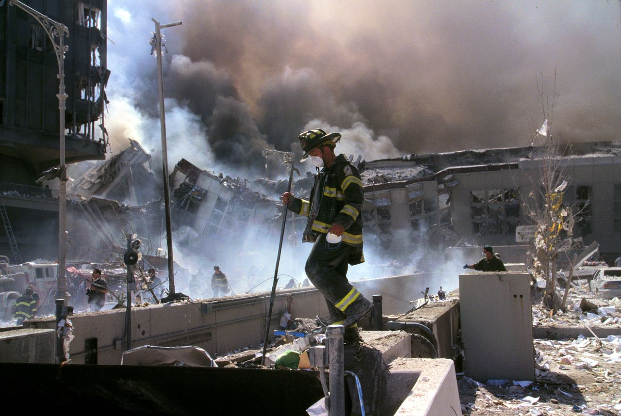 Fire_fighters_amid_smoking_rubble_after_September_11th_terrorist_attack_(29392249476)