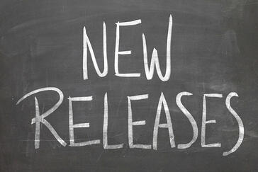 New Releases word in white chalk handwriting on the blackboard